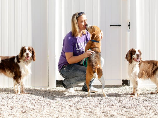 Happily Ever After Animal Sanctuary founder Amanda Reitz plays with some of the dogs at the no-kill shelter's new Green Bay Adoption Center at 2255 Fox Heights Lane in Ashwaubenon. Reitz started the nonprofit organization 10 years ago in her late grandfather's vacant barn near Marion.