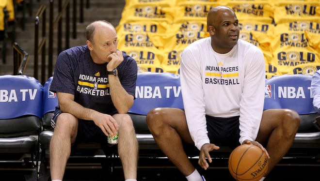 Indiana Pacers play the Washington Wizards in Game 1 of the Eastern Conference semifinals Monday, May 5, 2014,  at Bankers Life Fieldhouse. Pacers associate head coach Nate McMillan, right, and assistant coach Dan Burke look on from the sideline before their game.