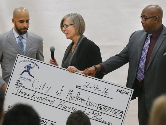 From left, Boston Red Sox pitcher David Price, Debbie Price, David Price's mother; and Bonnie Price, David Price's Dad, all with the David Price's foundation Project One Four, presented a check for $300,000 to start building the Miracle Fields ball Park, at McKnight Park during a luncheon, on Thursday, Feb. 4, 2016.