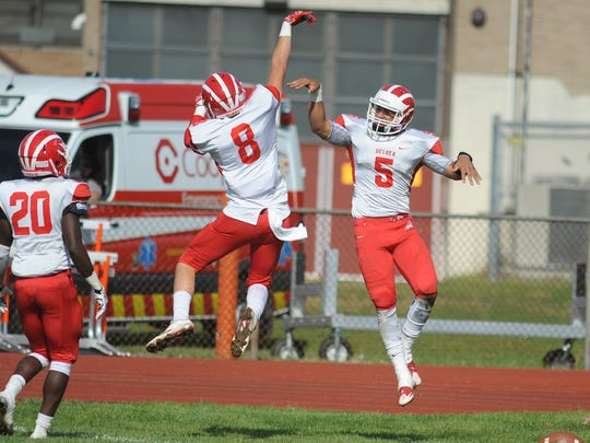 Delsea's Mason Maxwell (8) and Keelan Borguet (5) celebrate after a touchdown during a 23-19 win over Woodrow Wilson on Saturday.