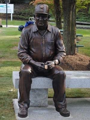 Part of the monument includes the depiction of a father holding his sons dog tags sitting on a bench.