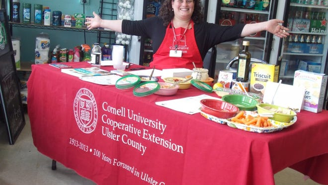 Maria Cecilia Deferrari, Cornell Cooperative Extension Ulster County educator and food forum host, poses at Rachel's Deli during a previous food event.