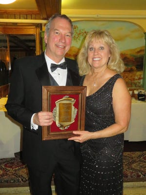 Tim Michelic (left), with wife Debbie, received the Okauchee Person of the Year award.
