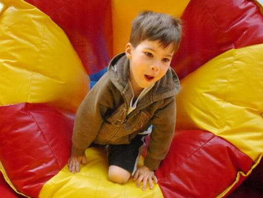 Then 4-year-old Trent Lewis of Glen Rock comes through a blow up tunnel in an obstacle course at the YMCA's Healthy Kids Day in 2010. The event encourages families to move more, foster learning and live healthier. (Daily Record/Sunday News -- Jason Plotkin)