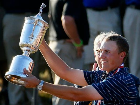 Jordan Spieth holds up the trophy after winning the  U.S. Open golf tournament at Chambers Bay on Sunday, June 21, 2015 in University Place, Wash.