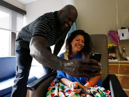 Shaquille O'Neal takes a selfie with Jovanna Medina-Cisneros,