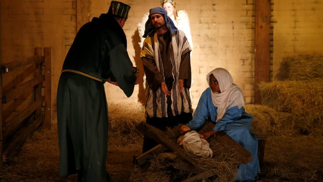 Church members portray Mary and Joseph in the manger scene with baby Jesus and the three wise men for living Christmas story at Killearn United Methodist Church.