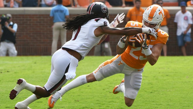 Tennessee wide receiver Josh Smith (25) is taken down by South Carolina defensive back JaMarcus King (7) during the first half Oct. 14, 2017, at Neyland Stadium in Knoxville.