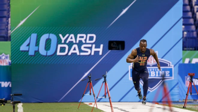 Washington wide receiver John Ross runs the 40-yard dash at the NFL football scouting combine in Indianapolis on March 4, 2017.