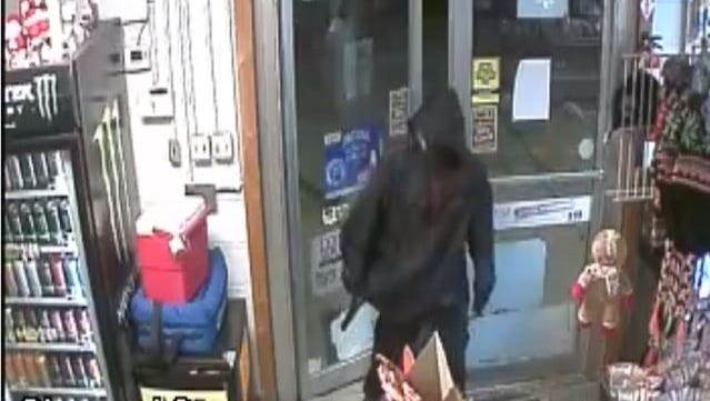 Authorities are seeking a suspect in an armed robbery of a convenience store near Canton Tuesday night.