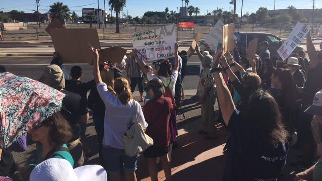 A group gathered outside the Army Corps Engineers office in downtown Phoenix Nov. 15, 2016 to protest the Dakota Access Pipeline. The protesters face Central Avenue after having gathered for a prayer.