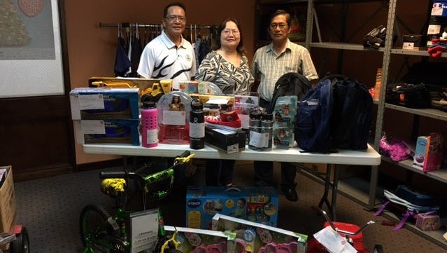 EASGC donated over 50 gift items in support of the Sugar Plum Tree Organization. Pictured from left is EASGC President Cesar Quinitio, Sugar Plum Tree President/Executive Director Bobbie Leon Guerrero and EASGC Past President Efren Tanag.