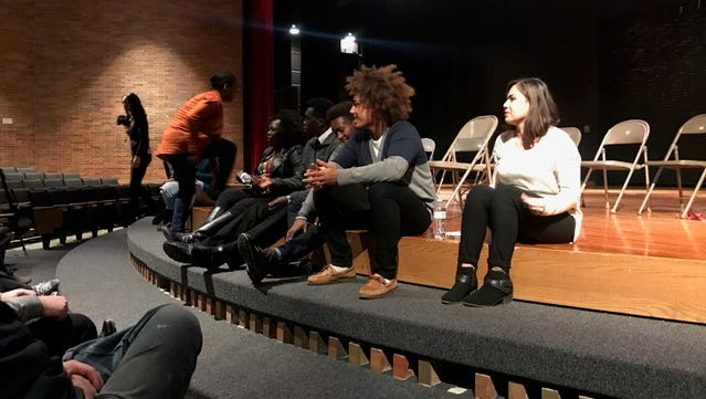 Three of the four student-athletes who knelt during the national anthem at Lansing Catholic High School took part in a community forum Wednesday night in Lansing.