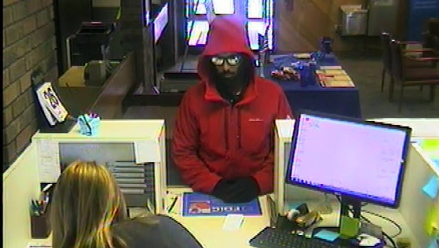Pictured is a suspect who authorities say left Lomira's BMO Harris Bank with an undisclosed amount of cash.