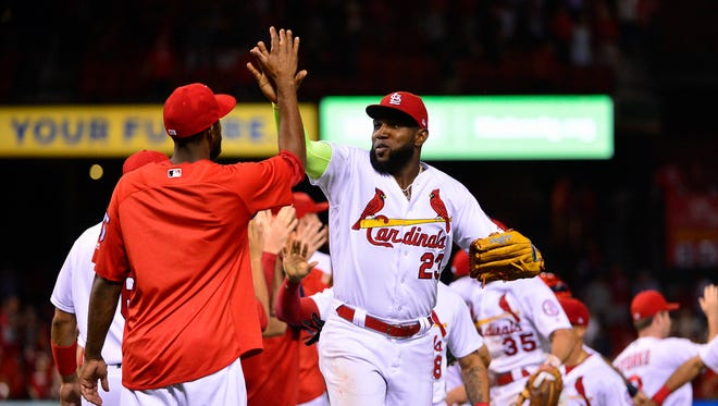 St. Louis Cardinals left fielder Marcell Ozuna (23) celebrates with right fielder Dexter Fowler (25) after the Cardinals defeated the Cleveland Indians at Busch Stadium.