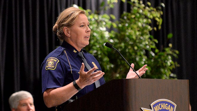 Col. Kristie Kibbey Etue, director of the Michigan State Police, speaks during the 128th Trooper Recruit School Graduation ceremony Friday, July 24, 2015, at the Lansing Center in Lansing.