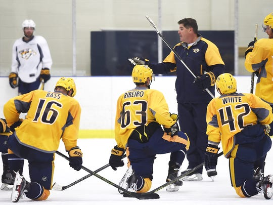 Predators Coach Peter Laviolette talks with his players during the Predators' first day of training camp Saturday Sept. 24, 2016, in Nashville, Tenn.
