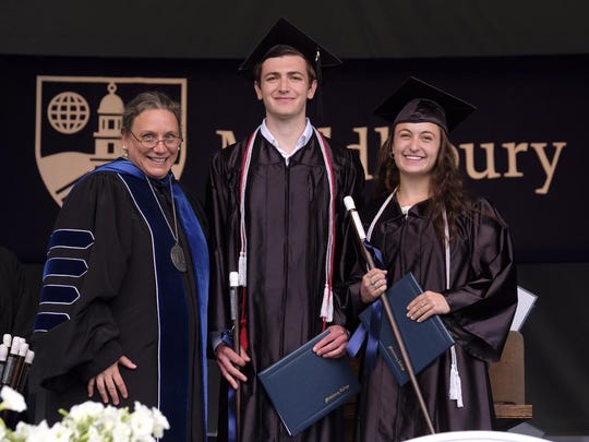 Middlebury College President Laurie Patton stands with Class of 2018 co-valedictorians, Ry Storey-Fisher of San Francisco, and Naomi Eisenberg of Newton, Massachuseets. at the Middlebury College commencement ceremony on Sunday.