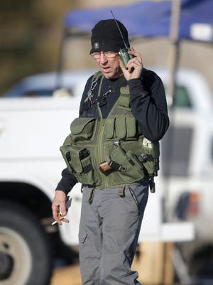 A member of the group occupying the Malheur National Wildlife Refuge stands guard on Friday.