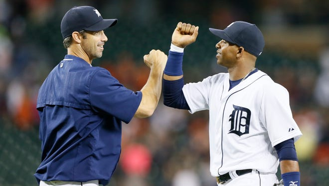 Tigers manager Brad Ausmus bumps elbows with Yoenis Cespedes in the post game handshake line after their 9-4 win over the Mariners at Comerica Park on Wednesday.
