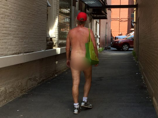 A naked man who declined to identify himself was spotted