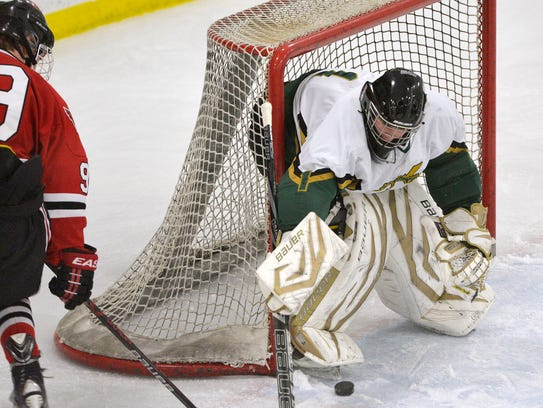 Sauk Rapids-Rice goalie Lukas Marlin stops a shot at