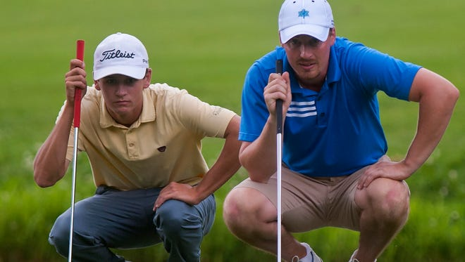 Drake Hull, left, and Bryan Smith line up their putts on the second day of the Vermont Amateur golf tournament at Burlington Country Club on Wednesday.