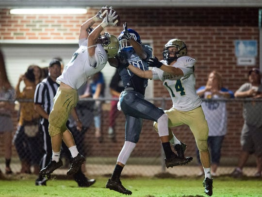 A pass intended for Harriman's Landon Cox is intercepted by Rockwood's Zander Price on Thursday, September 21, 2017. 14 was also covered