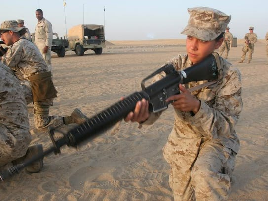 Military photos show former Cpl. Laura Buckingham wielding