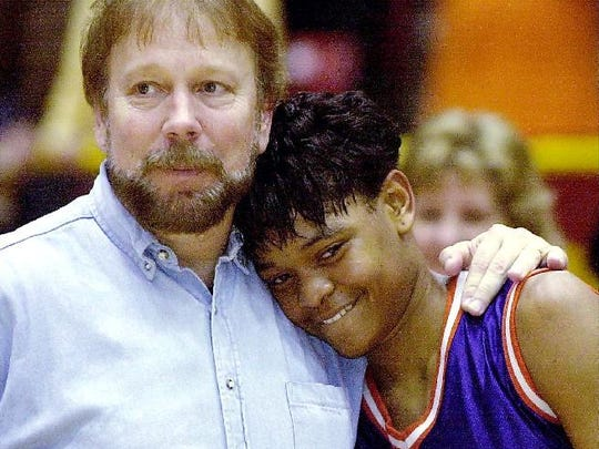 Former Southwood coach Steve McDowell hugs Alana Beard after the Cowboys won the 2000 Class 5A state basketball title. She scored 48 points and pulled down 20 rebounds in the contest.