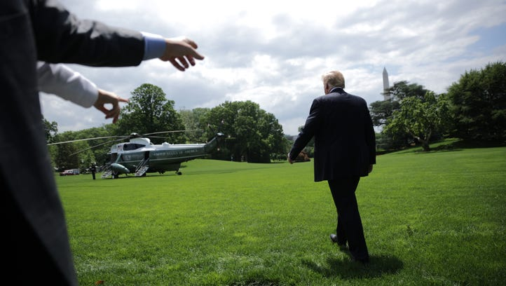 President Trump walks across the South Lawn while departing