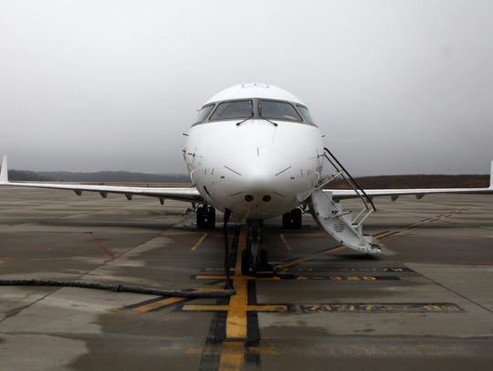 An Elite Airways CRJ200 sits parked at the Branson