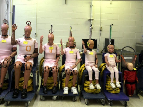 Vehicle crash test dummies await their turn at vehicle