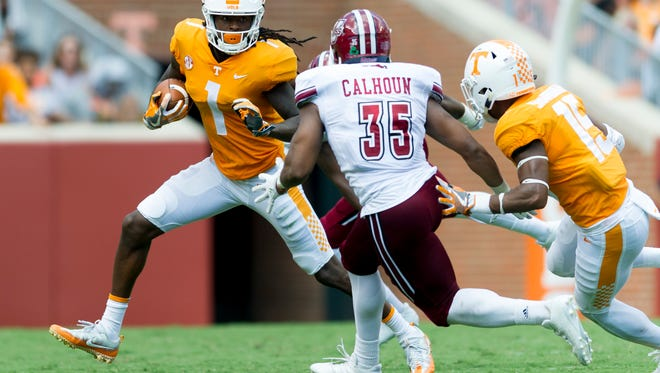 Tennessee wide receiver Marquez Callaway (1) runs the ball as UMass linebacker Colbert Calhoun (35) defends during the Tennessee Volunteers vs. UMass Minutemen game at Neyland Stadium in Knoxville, Tennessee on Saturday, September 23, 2017.