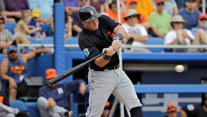 Detroit Tigers' James McCann lines a two-run single off Toronto Blue Jays starting pitcher R.A. Dickey during the second inning of a spring training baseball game Thursday, March 24, 2016, in Dunedin, Fla. Tigers' J.D. Martinez and Steven Moya both scored.