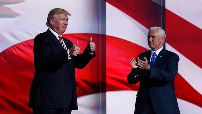 Republican presidential nominee Donald Trump and his vice presidential running mate, Indiana Gov. Mike Pence (shown July 20, 2016, during the Republican National Convention in Cleveland), appeared to differ Wednesday, July 27, on the hacking of Democratic National Committee emails.