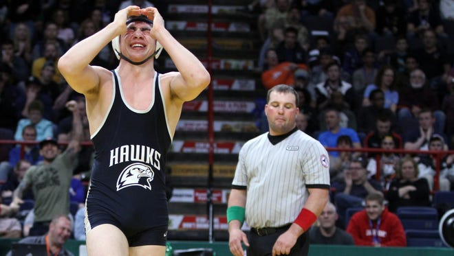 Matt Grippi lays on the mat as Peter Pappas of Plainview celebrates after winning the 152 pound championship at the finals of the NYSPHSAA Wrestling Championships at the Times-Union Arena in Albany Feb. 25, 2017.