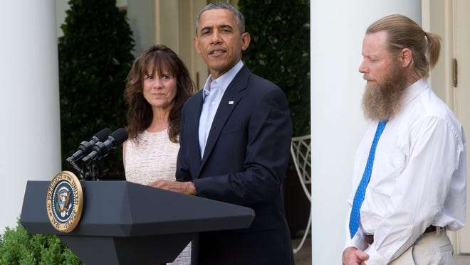 President Obama makes a statement about the release of Sgt. Bowe Bergdahl as his parents, Jani Bergdahl, left, and Bob Bergdahl listen May 31 in the Rose Garden at the White House in Washington.