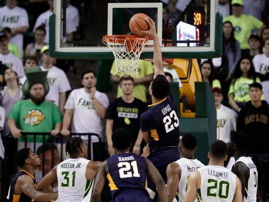 West Virginia forward Esa Ahmad (23) dunks against West Virginia during the second half of an NCAA college basketball game Tuesday, Feb. 20, 2018, in Waco, Texas. (AP Photo/Tony Gutierrez)