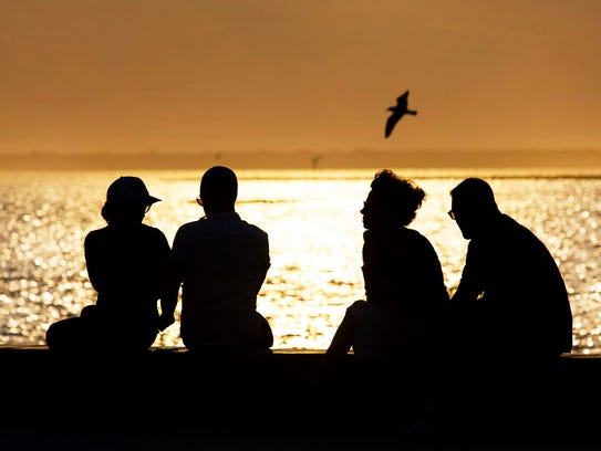 Visitors await sunset at Bayview Park in Beach Haven.
