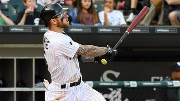 Brett Lawrie hits a three-run home run during the fifth