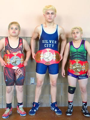From left, Luke Sandoval, Lonnie Sandoval and Landon Sandoval wearing their Greater Southwest belts proudly.