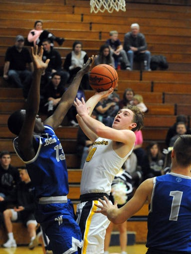 Lancaster's Dominic Boring takes a shot against Washington