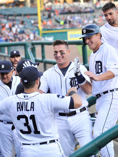 Detroit's Alex Avila congratulates James McCann on