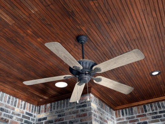 An exposed wood ceiling adds a feel of elegance to an outdoor space.