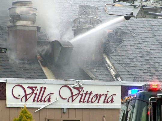 Firefighters battle a multi-alarm fire at the Villa Vittoria restaurant on Hooper Avenue in Brick Monday, July 4, 2016.