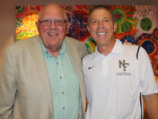 Longtime Harrison head coach John Herrington (left)