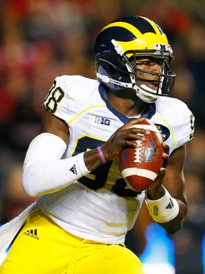 Michigan quarterback Devin Gardner (98) looks to pass against Rutgers during the second half of an NCAA college football game Saturday, Oct. 4, 2014, in Piscataway, N.J. (AP Photo/Rich Schultz)