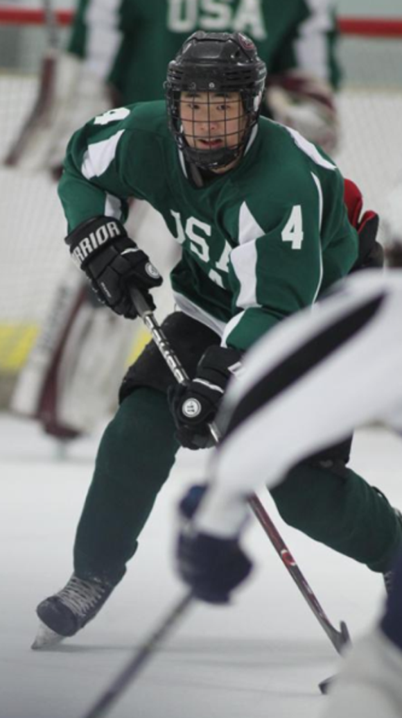 David Ma advances the puck during pool play at the