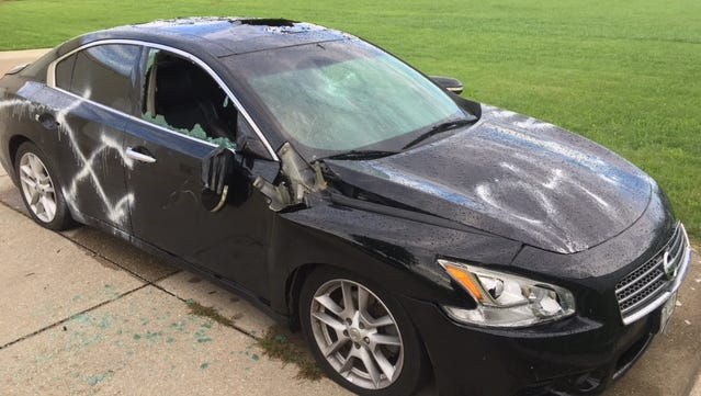 Authorities are looking for the people responsible for vandalism to this vehicle in Waukee.